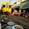 Seafood stall beside the railway track at the famous Railway market. See the train passing on our private railway market tour from Bangkok.