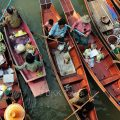 Farmers buying and selling produce at Tha Kha floating market