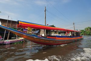 Explore local life on a canal tour in Bangkok by private long-tailed boat. See old wooden houses on stilts, greener areas, and local life along the canals.