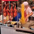 A busy local restaurant selling noodles with duck in Chinatown