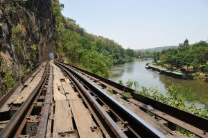 Visit Krasae cave and wooden railway bridge on a tour from Bangkok to Kanchanaburi. The bridge was constructed on the slope of a steep cliff.