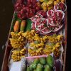 Local fruits for sale on a boat at Damnoen Saduak floating market