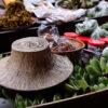 Goods on sale at Damnoen Saduak floating market. Enjoy local fruits and snacks on our floating market tour from Bangkok.