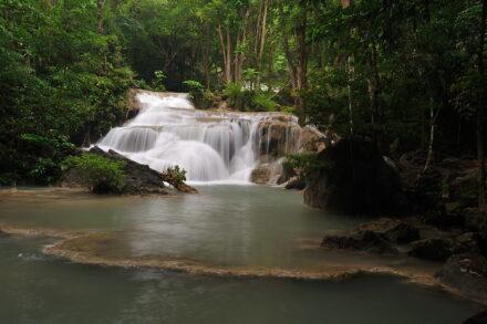 Waterfall at Erawan National Park in Kanchanaburi. Visit it on our Erawan waterfall tour from Bangkok.
