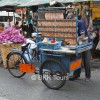 Local snack - grilled dried squids - at Bangkok's biggest flower market