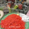 Chillies of different sizes and colors at  Bangkok's biggest flower market