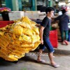 Marigolds being transported to vendors at the flower market who will turn them into garlands