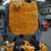 A truck unloading marigolds at the flower market to be made into garlands
